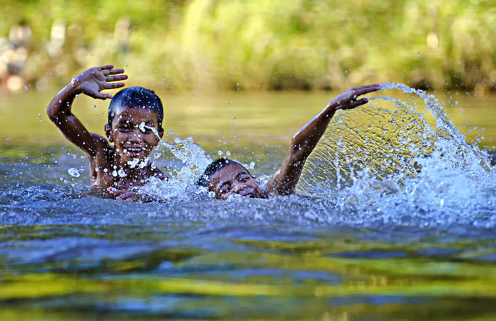 Boys frollick in the Nam Tha (river) at Nalea, Laos.