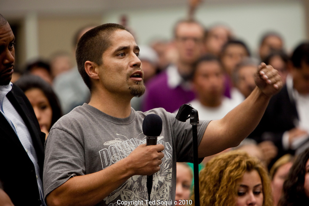 Hundreds of residents from the Westlake area of L.A. hold a community meeting to meet with L.A.P.D. officials to ask questions, and to get information about the recent shooting death of an area resident by L.A.P.D. .Manuel Jamines, a Guatemalan immigrant, was shot and killed by a L.A.P.D officer when he refused to drop a knife he was wielding..Residents heckled L.A.P.D. Chief Charlie Beck, and took to the streets for the third night in a row to protest the shooting.