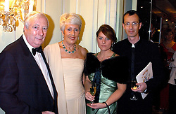 Left to right, LORD HARRIS OF PECKHAM, his wife DAME PAULINE HARRIS and MARTIN & ZOE HARRIS he is the son of Lord Harris of Peckham at the Dyslexia Awards Dinner attended by HRH The Countess of Wessex held at The Dorchester Hotel, Park Lane, London on 9th November 2005.<br />