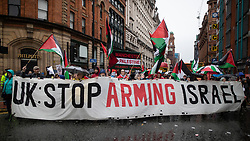 © Licensed to London News Pictures . 29/09/2019. Manchester, UK. UK Stop Arming Israel banner carried by supporters of the Manchester Palestine Solidarity Campaign . Thousands attend a march for the People's Assembly . Demonstrations for and against Brexit , austerity measures , the environment and numerous social issues take place across Manchester during the first day of the Conservative Party Conference taking place at the Manchester Central Exhibition Centre . Photo credit: Joel Goodman/LNP