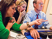 "28 OCTOBER 2010 - PHOENIX, AZ: Janey Pearl, the campaign press secretary, Sarah Acer, a volunteer and Terry Goddard take questions from computer users at the last ""Tweetup"" of the campaign. Goddard took questions and provided answers to Twitter users in real time. Goddard lost the election to sitting Governor Jan Brewer, a conservative Republican.     PHOTO BY JACK KURTZ"