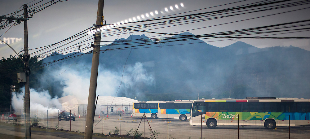 A mosquito truck sprays a bus compound in Rio de Janeiro on August 16, 2016.