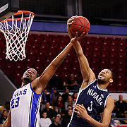 Titans' Kevin Rogers is blocked by CJ Aiken of the Niagara River Lions on Saturday at the Aud. Niagara beat the Titans 103-96.<br /> <br /> IAN STEWART / SPECIAL TO THE RECORD