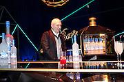 JEAN-PAUL GAULTIER, Grey Goose character and cocktails. The Elton John Aids Foundation Winter Ball. off Nine Elms Lane. London SW8. 30 October 2010. -DO NOT ARCHIVE-© Copyright Photograph by Dafydd Jones. 248 Clapham Rd. London SW9 0PZ. Tel 0207 820 0771. www.dafjones.com.