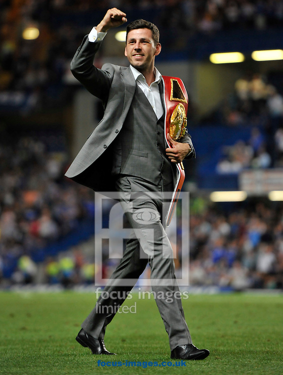 Picture by Alan Stanford/Focus Images Ltd +44 7915 056117<br /> 21/08/2013<br /> Darren Barker the new IBF middle weight of the world displays his belt during half time at the Barclays Premier League match at Stamford Bridge, London.