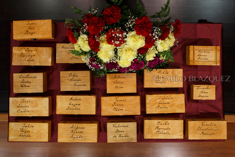 19/05/2018. Boxes reading the names of people assassinated by dictator Francisco Franco's forces and containing their belongings are seen during a ceremony to hand the remains of 22 people to their relatives on May 19, 2018 in Guadalajara, Spain. General Franco's forces killed Timoteo Mendieta and other people between 1939 and 1940 after Spain's Civil War and buried them in mass graves in Guadalajara's cemetery. Argentinian judge Maria Servini used the international human rights law and ordered the exhumation and investigation of Mendieta's mass grave. The exhumation was carried out by Association for the Recovery of Historical Memory (ARMH) recovering 50 bodies from 2 mass graves and identified 24 of them. Spain's Civil War took the lives of thousands of people on both sides, but Franco continued his executions after the war has finished. Spanish governments has never done anything to help the victims of the Civil War and Franco's dictatorship while there are still thousands of people missing in mass graves around the country. (© Pablo Blazquez)