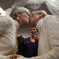 Osceola County Commisioner Cheryl Grieb, left, and Patti Daugherty, right, kiss each other after Osceola County Florida's first gay marriage was performed shortly after midnight on January 6, 2015 at the Osceola County courthouse in Kissimmee, Florida.  (AP Photo/Alex Menendez)