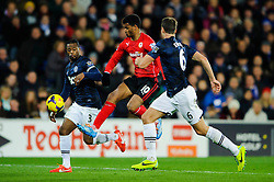 Cardiff Forward Fraizer Campbell (ENG) beats Man Utd Defender Patrice Evra (FRA) and Defender Jonny Evans (NIR) during the second half of the match - Photo mandatory by-line: Rogan Thomson/JMP - Tel: Mobile: 07966 386802 - 24/11/2013 - SPORT - FOOTBALL - Cardiff City Stadium - Cardiff City v Manchester United - Barclays Premier League.