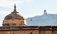 From inside the Amer Fort looking out at the outer walls on the surrounding steep hillsides. This is the third longest wall on Earth behind the Great wall of China and another. Amer, India, near Jaipur, Rajasthan, India.