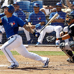March 8, 2011; Dunedin, FL, USA; Toronto Blue Jays catcher J.P. Arencibia (9) hits a two run homerun during the bottom of the second inning of a spring training game against the New York Yankees at Florida Auto Exchange Stadium. Mandatory Credit: Derick E. Hingle-US PRESSWIRE