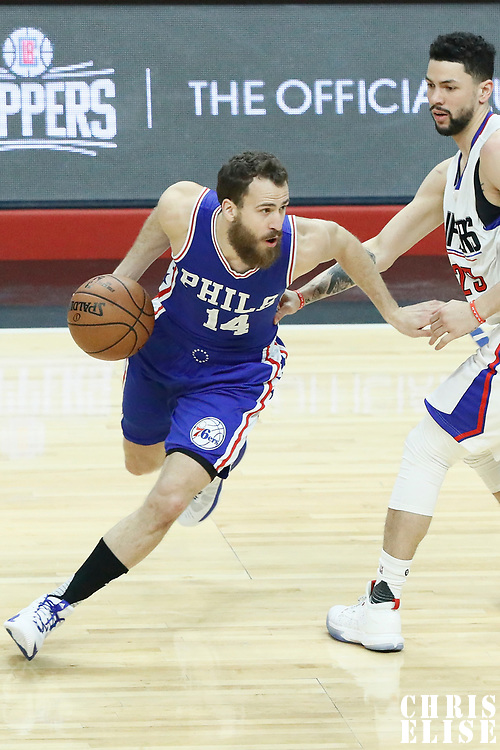 11 March 2017: Philadelphia 76ers guard Sergio Rodriguez (14) drives past LA Clippers guard Austin Rivers (25) during the LA Clippers 112-100 victory over the Philadelphia Sixers, at the Staples Center, Los Angeles, California, USA.