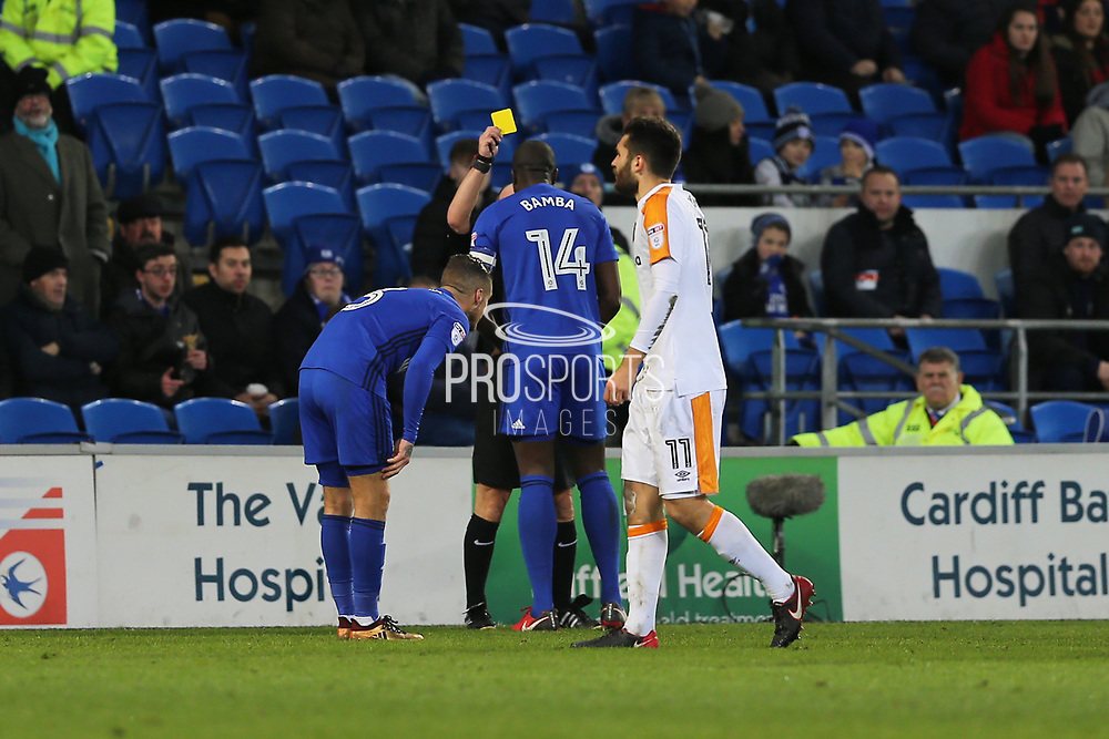 Cardiff City  Souleymane Bamba (14) gets a yellow card from referee C. Duncan during the EFL Sky Bet Championship match between Cardiff City and Hull City at the Cardiff City Stadium, Cardiff, Wales on 16 December 2017. Photo by Gary Learmonth.