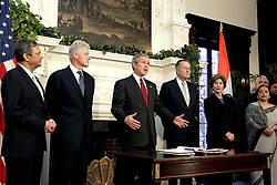 U.S. President George W. Bush , first lady Laura Bush (2nd r) and former Presidents Bill Clinton (l) and George H. W. Bush (r) visit the Indian embassy in Washington, January 3, 2005. Bush brought together former presidents George Bush and Clinton on Monday to launch an appeal for Americans to make a donation to help victims of the South Asia quake and tsunamis. The president's father and Clinton will lead a bipartisan effort to seek out donations both large and small to provide relief assistance to millions left homeless by the Dec. 26 calamity that killed thousands in Indonesia, Sri Lanka, India and Thailand. Photo by Chuck Kennedy/KRT/ABACA.