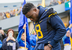 Nov 28, 2015; Morgantown, WV, USA; West Virginia Mountaineers safety Karl Joseph (8) is honored on senior day before their game against the Iowa State Cyclones at Milan Puskar Stadium. Mandatory Credit: Ben Queen-USA TODAY Sports