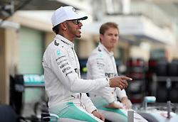 Mercedes' Lewis Hamilton with team mate Nico Rosberg during the end of year team photo before the Abu Dhabi Grand Prix at the Yas Marina Circuit, Abu Dhabi.