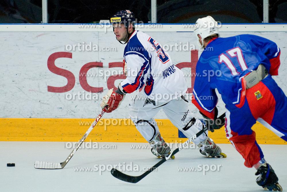 Milos Vavrusa of Czech Republic chased by Matic Kralj, 17, of Slovenia at IIHF In-Line Hockey World Championships Quarter final match between national teams of Czech Republic and Slovenia on July 1, 2010, in Karlstad, Sweden. (Photo by Matic Klansek Velej / Sportida)