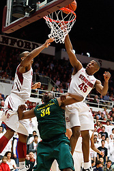 January 27, 2011; Stanford, CA, USA;  Oregon Ducks forward Joevan Catron (34) shoots past Stanford Cardinal guard Jeremy Green (45)during the first half at Maples Pavilion.