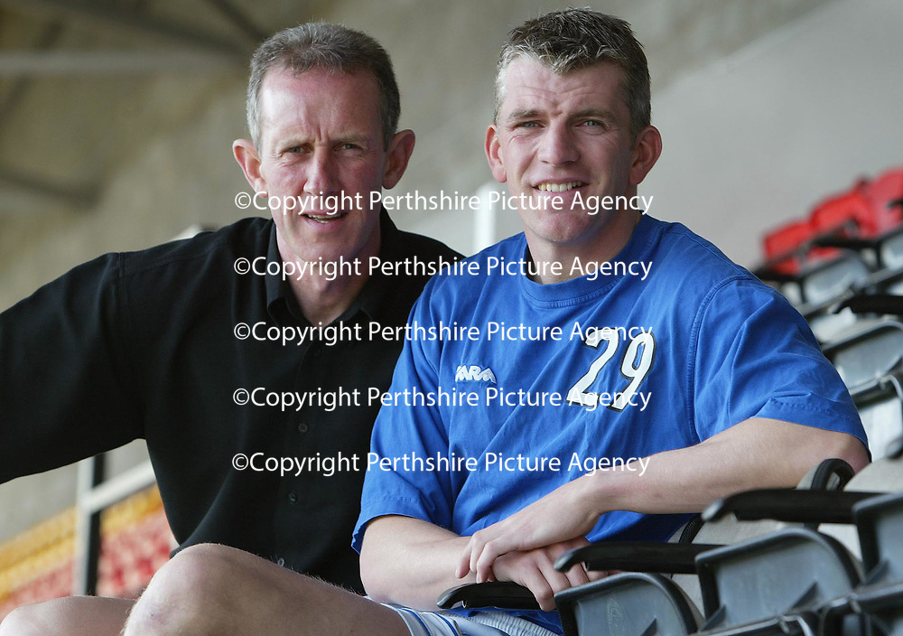 St Johnstone's Jim Weir, happy after signing a 12 month contract today despite his recent injury hell... He is pictured with manager Billy Stark.<br />see story by Gordon Bannerman Tel: 07729 865788<br />Picture by Graeme Hart.<br />Copyright Perthshire Picture Agency<br />Tel: 01738 623350  Mobile: 07990 594431