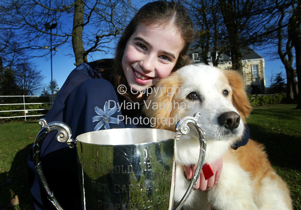 23/11/2003.Free Picture No Charge..Pictured yesterday at 2003 Stronghold Veterinary Pet Care Awards at the Citywest Hotel was Sarah O Connor aged 10 whose mum Annette Quegan  from Barrowside Veterinary Hospital in Rosbercon, New Ross, County Wexford  was presented with perpetual Stronghold Trophy. Also in the picture is Sarah's dog Homer..Picture Dylan Vaughan