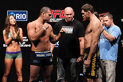 August 26, 2011; Rio De Janiero, Brazil; Mauricio Rua (left) and Forrest Griffin (right) pose after weighing in for their upcoming bout at UFC 134.