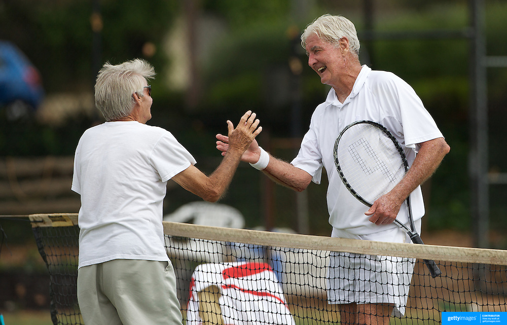 Lorne Main, Canada,( left) and John Powless, USA, after their 75 Mens Singles match during the 2009 ITF Super-Seniors World Team and Individual Championships at Perth, Western Australia, between 2-15th November, 2009.