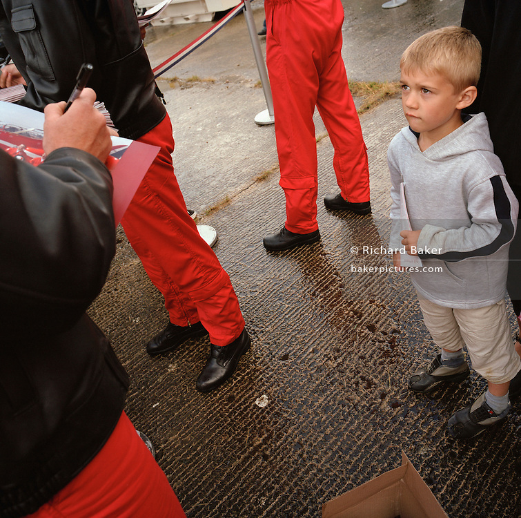 Young boy struck with awe at meeting pilot with the 'Red Arrows', Britain's Royal Air Force aerobatic team at air shiow.