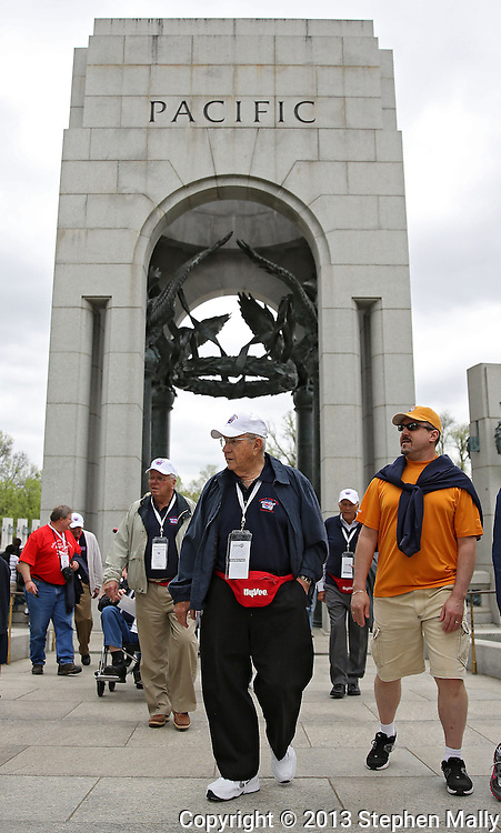Korea War Veteran John Falk of Cedar Falls walks back towards the bus during the Sullivan-Hartogh-Davis Post 730 Honor Flight  at the National World War II Memorial in Washington, DC on Tuesday, April 16, 2013. About 90 veterans were on the trip. After their visit to the National World War II Memorial they would take a bus tour of Washington, DC followed by a visit to the Korean War Veterans Memorial.
