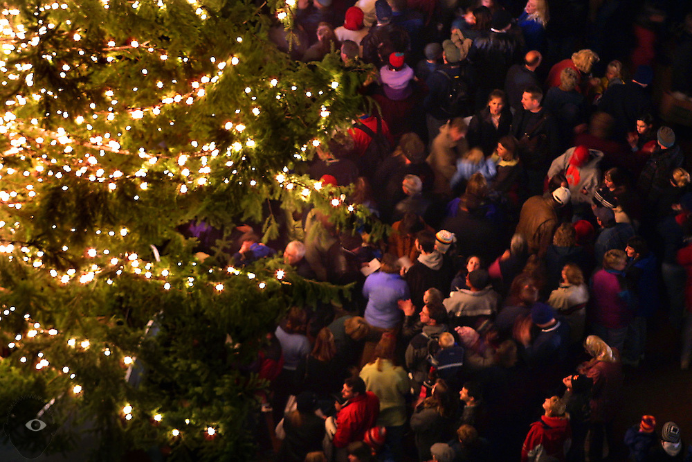 Holiday revelers in Portland enjoy the annual Christmas tree lighting and music by Melody Guy on Friday night at Pioneer Courthouse Square.