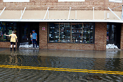 October 10, 2018 - Tarpon Springs, Florida, U.S. - High tide from offshore hurricane Michael creeps up into the Sponge Docks in Tarpon Springs Wednesday afternoon 10/10/2018 after the Anclote River backs up. (Credit Image: © Jim Damaske/Tampa Bay Times via ZUMA Wire)