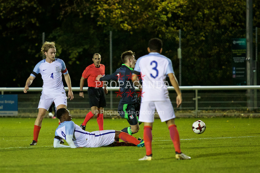 BANGOR, WALES - Saturday, November 12, 2016: Wales' Ben Woodburn is brought down for a penalty against England during the UEFA European Under-19 Championship Qualifying Round Group 6 match at the Nantporth Stadium. (Pic by Gavin Trafford/Propaganda)