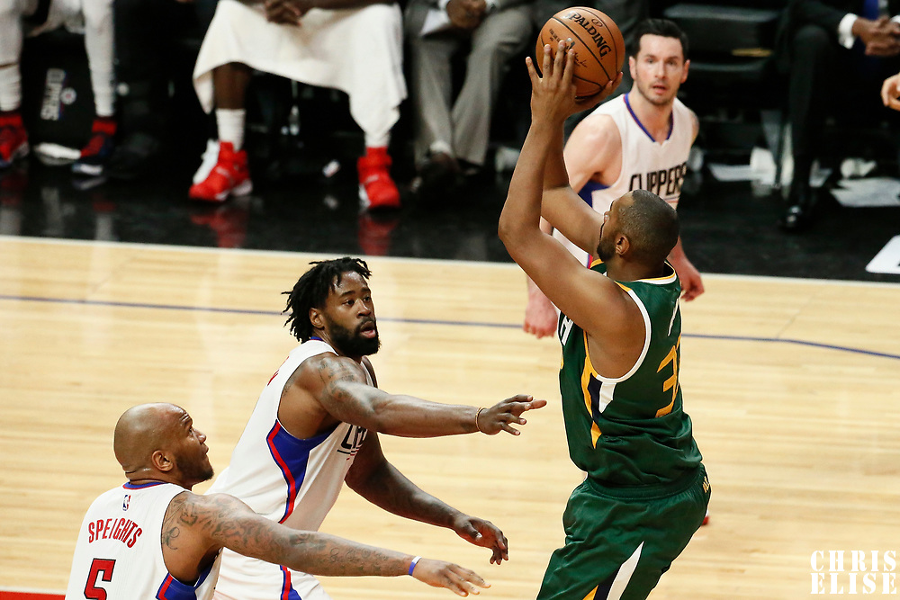 25 April 2017: Utah Jazz center Boris Diaw (33) takes a jump shot over LA Clippers center Marreese Speights (5) and LA Clippers center DeAndre Jordan (6) during the Utah Jazz 96-92 victory over the Los Angeles Clippers, during game 5 of the first round of the Western Conference playoffs, at the Staples Center, Los Angeles, California, USA.