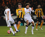 Manchester United's Phil Jones wins the battle against Cambridge United Liam Hughes during the The FA Cup match between Cambridge United and Manchester United at the R Costings Abbey Stadium, Cambridge, England on 23 January 2015. Photo by Phil Duncan.