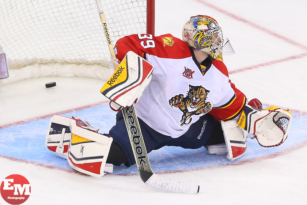 Mar 31, 2014; Newark, NJ, USA; New Jersey Devils center Jacob Josefson (16) (not shown) scores a goal on Florida Panthers goalie Dan Ellis (39) during the third period at Prudential Center. The Devils defeated the Panthers 6-3.