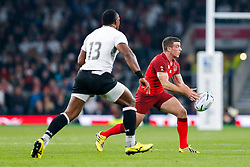 England Fly-Half George Ford is challenged by Fiji Outside Centre Vereniki Goneva - Mandatory byline: Rogan Thomson/JMP - 07966 386802 - 18/09/2015 - RUGBY UNION - Twickenham Stadium - London, England - England v Fiji - Rugby World Cup 2015 Pool A.