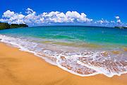 Empty beach and blue waters on Hanalei Bay, Island of Kauai, Hawaii