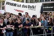Frankfurt am Main | 21 Apr 2015<br /> <br /> Am Dienstag (21.04.2015) hielt die rassistische und islamfeindliche Gruppe PEGIDA (Patriotische Europ&auml;er gegen die Islamisierung des Abendlandes) an der Hauotwache neben der Katharinenkirche in Frankfurt am Main eine Mahnwache unter dem Motto &quot;Wir sind wieder da&quot; ab. Die Kundgebung war wie immer mit Hamburger Gittern abgesperrt und von starken Polizeikr&auml;ften bewacht. Etwa 1000 Menschen nahmen an den Gegenprotesten teil.<br /> Hier: Gegenproteste mit einem Transparent der Partei &quot;Die Partei&quot; mit der Aufschrift &quot;Wirr ist das Volk&quot;.<br /> <br /> &copy;peter-juelich.com<br /> <br /> [Foto Honorarpflichtig | No Model Release | No Property Release]