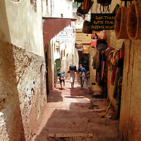 Small Alley in Fes el Bali at Fez, Morocco <br /> The Medina of Fez is a labyrinth of thousands of small alleys and very narrow paths. They are canvassed by tarps, scrap metal and loosely fixed wood. These ramshackle canopies are designed to block the sweltering summer heat which averages above 90&deg; F. Stepping inside Fes el Bali is a step back into medieval history. It is essential to have a guide when visiting or you will quickly get lost within its winding 692 acres.