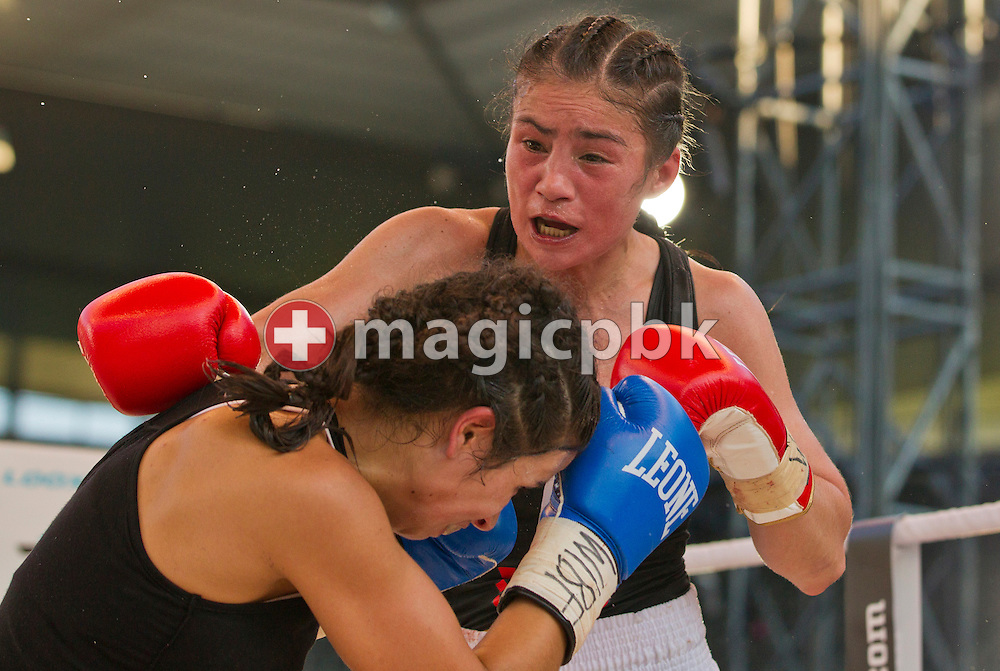 Aniya Seki of Switzerland (R) fights against Eva Marcu of Hungary during their Super Flyweight title fight at the Stade de Suisse Wankdorf in Bern, Switzerland, Saturday, July 7, 2012. (Photo by Patrick B. Kraemer / MAGICPBK)