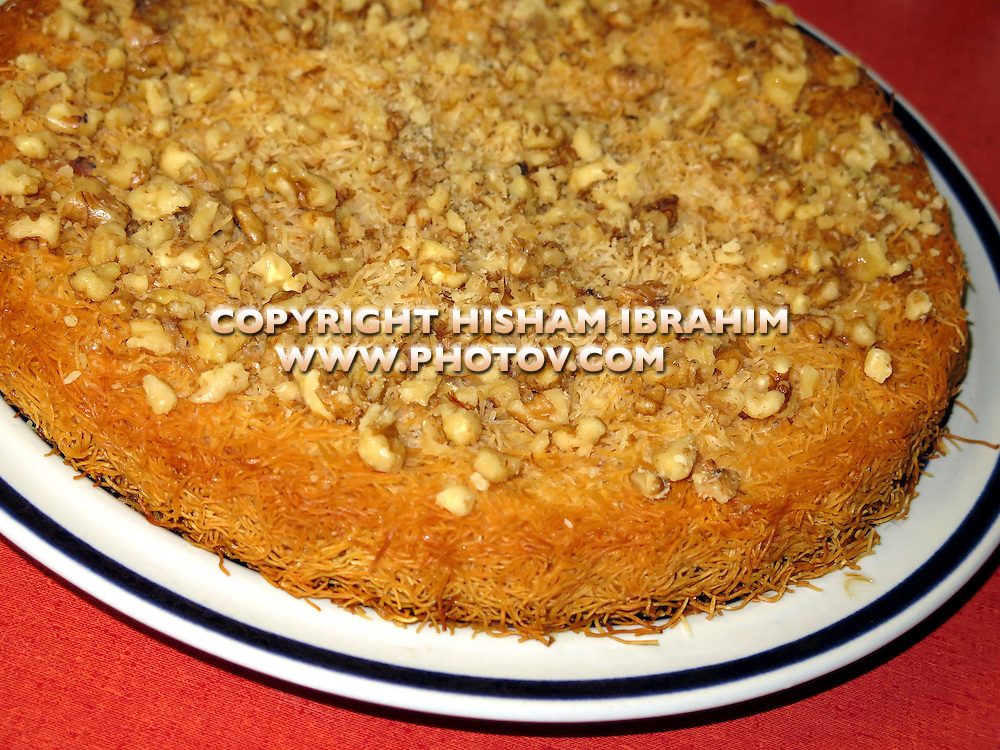 Homemade Kunafah, a traditional Middle Eastern Dessert covered with Walnuts