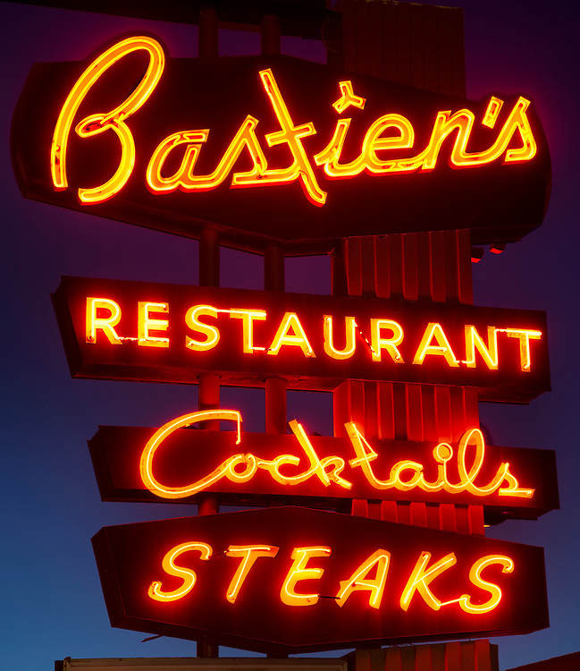 Opened in 1937, Bastien's Restaurant prides itself on its retro atmosphere.  Its vintage neon sign helps preserve the post-war road trip scene still found on Colfax Avenue.