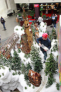 Zach Busse of Alexandria, Kentucky adds some snow as the Huntington Holiday Train display setup nears completion at the main branch of the Columbus Metropolitan Library in downtown Columbus, Sunday, November 25, 2012..The trains are setup by Applied Imagination on Saturday and Sunday and will run through mid-January.