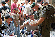 Israel, Jerusalem, border police patrol in the Muslim quarter, old city of Jerusalem helping a disabled tourist