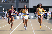 May 24, 2019; Sacramento, CA, USA; Lanae-Tava Thomas (center) and Anglerne Annelus of Southern California place first and second in a women's 100m heat in 11.19 and 11.20 during the NCAA West Preliminary at Hornet Stadium.