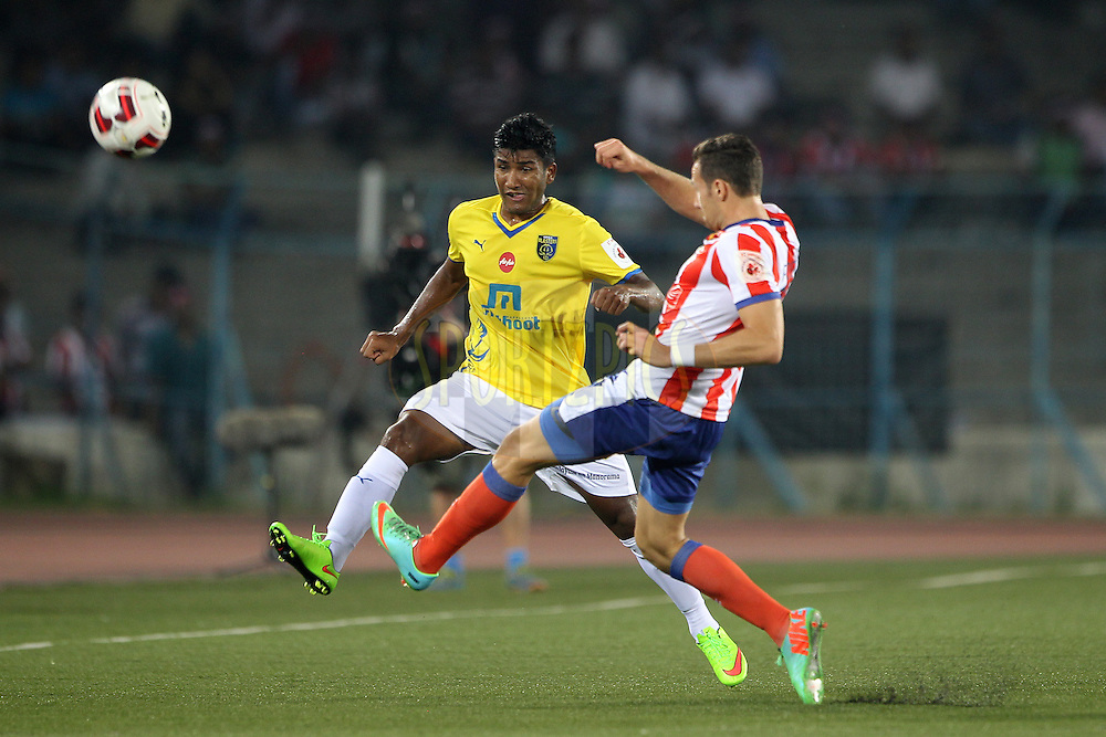 Nirmal Chettri of Kerala Blasters FC and Jakub Podany of Atletico de Kolkata during match 13 of the Hero Indian Super League between Atl&eacute;tico de Kolkata and Kerala Blasters FC held at the Salt Lake Stadium in Kolkata, West Bengal, India on the 26th October 2014.<br /> <br /> Photo by:  Ron Gaunt/ ISL/ SPORTZPICS