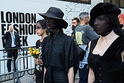 London, UK. 17 September, 2019. Climate activists from Extinction Rebellion stage a RIP London Fashion Week Funeral March to call on both the public and the fashion industry to demand an end to London Fashion Week and the unsustainable system of consumption which it promotes. The event included a pause to reflect on the lives already lost and those that will be lost as a result of the climate and ecological crisis.