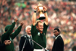 South Africa captian Francois Pienaar lifts the World Cup trophy after victory over New Zealand