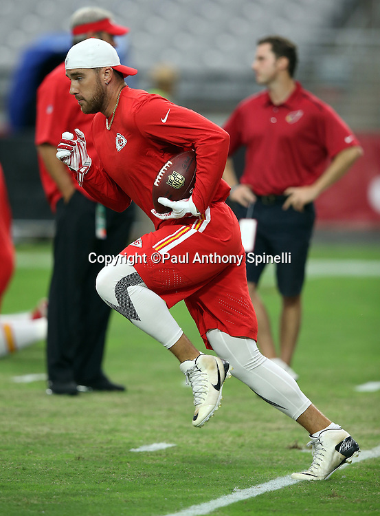 Kansas City Chiefs tight end Travis Kelce (87) runs with the ball after catching a pass while warming up before the 2015 NFL preseason football game against the Arizona Cardinals on Saturday, Aug. 15, 2015 in Glendale, Ariz. The Chiefs won the game 34-19. (©Paul Anthony Spinelli)