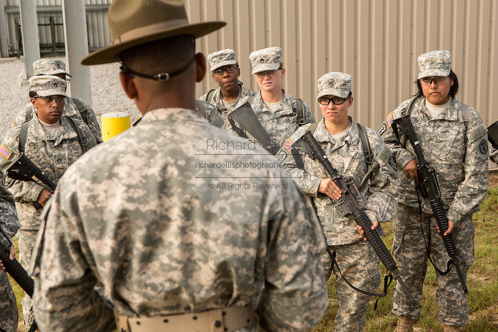 Women Drill Sergeant candidates listen to their instructor at the US Army Drill Instructors School Fort Jackson September 26, 2013 in Columbia, SC. While 14 percent of the Army is women soldiers there is a shortage of female Drill Sergeants.