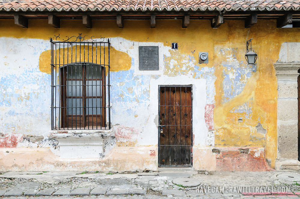 The rundown exterior of a colonial building in Antigua, Guatemala.
