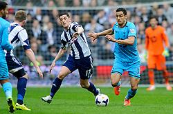 Nacer Chadli (BEL) of Tottenham Hotspur is challenged by Graham Dorrans (SCO) of West Brom - Photo mandatory by-line: Rogan Thomson/JMP - 07966 386802 - 12/04/2014 - SPORT - FOOTBALL - The Hawthorns Stadium - West Bromwich Albion v Tottenham Hotspur - Barclays Premier League.
